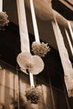 Wedding flowers decoration. Hanging wedding flowers on the front door of a church Royalty Free Stock Photo