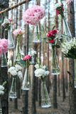 Wedding flowers decoration arch in the forest. The idea of a wedding flower decoration. Wedding concept in nature Stock Photos