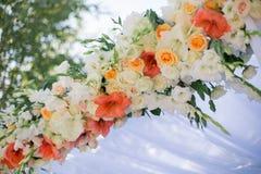 Wedding Flowers Decoration. Wedding reception centerpiece close-up with pastel orange and white Stock Photos