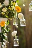 Wedding Flowers Decoration. Wedding reception centerpiece close-up with pastel orange and white Royalty Free Stock Image