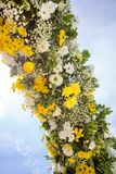 Wedding Flowers Decoration. Wedding reception centerpiece close-up with pastel yellow and white Stock Photos