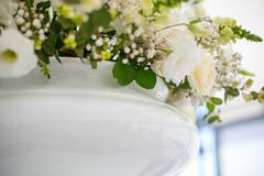 Wedding Flowers Decoration. Wedding reception centerpiece close-up with pastel yellow and white Royalty Free Stock Images