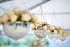 Wedding Flowers Decoration. Wedding reception centerpiece close-up with pastel yellow and white Royalty Free Stock Photography