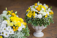 Wedding Flowers Decoration. Wedding reception centerpiece close-up with pastel yellow and white Stock Photo
