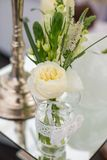 Wedding Flowers Decoration. Wedding reception centerpiece close-up with pastel yellow and white Stock Images