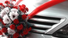 Wedding flowers decorations on a car Royalty Free Stock Image