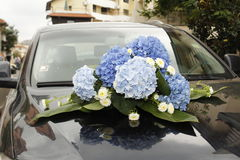 Wedding flowers on a expensive car Stock Images