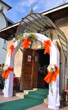 Wedding flowers on the front door of a church. Wedding flowers and decorations at the church entrance Stock Photo