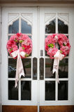 Wedding flowers on the front door of a church. An image of Wedding flowers on the front door of a church Stock Photo