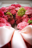Wedding flowers on the front door of a church Royalty Free Stock Images