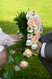 Wedding flowers in hands stock image