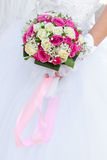 Wedding  flowers in hands of the bride Royalty Free Stock Images