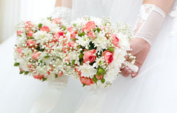 Wedding  flowers in hands of the bride Stock Image