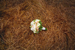 Wedding flowers on the hay field. Rustic style. Stock Photography