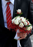 Wedding flowers husband. Closeup of a fiance in suit with wedding flowers Royalty Free Stock Photo