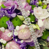 Wedding flowers and jewelery. Wedding flower bouquet detail decorated with jewelery Royalty Free Stock Photos