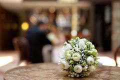 Wedding flowers laying on a table Royalty Free Stock Photos