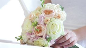 Wedding flowers lie on the keys of the piano. She takes the bouquet stock footage