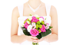 Wedding flowers. A picture of wedding flowers and a bride over white background Stock Photo