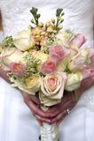 Wedding flowers and ring. Held at waist high Royalty Free Stock Images