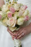 Wedding flowers and ring. Held at waist high Stock Photography