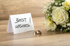 Wedding Flowers, Rings and Card on Wooden Table Stock Image