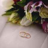 Wedding flowers and rings close up. Wedding rings and flowers close up Stock Images