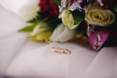 Wedding flowers and rings close up. Wedding rings and flowers close up Royalty Free Stock Photos