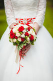 Wedding Flowers Roses Bouquet in Bride Hands with White Dress on Background Stock Photos