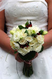 Wedding flowers at waistline. Held by bride Royalty Free Stock Photos