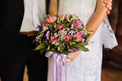 Wedding flowers, wedding bouquet, the bride and groom sitting next to the bride Royalty Free Stock Image