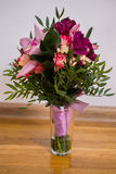 Wedding flowers, wedding bouquet of red and pink peach yellow roses and blue violet purple orchid Stock Photo