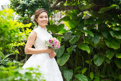 Wedding flowers ,Woman holding colorful bouquet Stock Photo