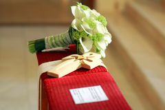 Wedding flowers with wooden cross Stock Photo