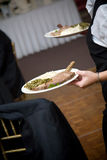 Wedding food being served by a waiter Royalty Free Stock Photos