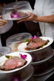 Wedding food being served by a waiter stock photos