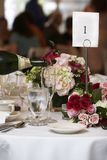 Wedding food and drink. Champagne being poured into fluted glasses during a wedding or social event stock photography