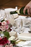 Wedding food and drink. Champagne being poured into fluted glasses during a wedding or social event stock photo