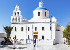 Wedding in front of beautiful church in Oia, Santorini, Greece royalty free stock photography