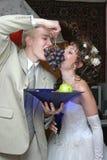 Wedding fruit. Bridegroom and bride eat grape Stock Photo