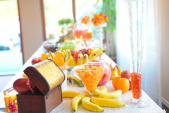 Wedding fruits table. Bananas peaches grapes oranges watermelone at wedding table fruits royalty free stock photo