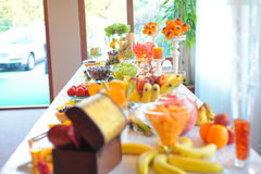 Wedding fruits table. Bananas peaches grapes oranges watermelone at wedding table fruits mixed royalty free stock photos