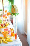Wedding fruits table. Bananas peaches oranges watermelone at wedding table fruits stock photography