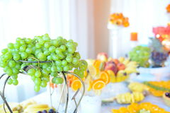Wedding fruits table with grapes. Grapes at wedding table with fruits royalty free stock image