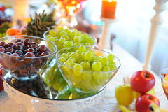 Wedding fruits table with grapes. Grapes at wedding table with fruits royalty free stock photo