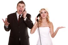Wedding fury couple phone yelling, relationship difficulties. Wedding couple relationship difficulties. Angry women men talking phone yelling at each other royalty free stock photos