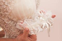 Wedding garter of the bride Stock Photos