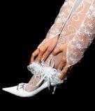 Wedding garter in hands on leg Royalty Free Stock Photography