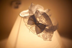 Wedding garter lace on lamp royalty free stock image