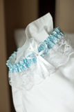 Wedding garter. A lace and silk wedding garter Royalty Free Stock Photography
